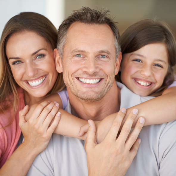 A smiling family at Surprise Oral & Implant Surgery in Surprise, AZ