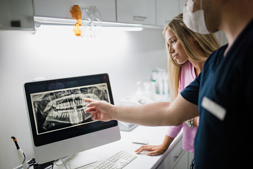 Woman looking at her x-ray at Surprise Oral & Implant Surgery in Surprise, AZ